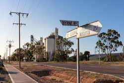 Silos by the road, used to store wheat grain for agricultural purposes. Storage warehouse for food industry by the road from Port Augusta to Ceduna, South Australia countryside