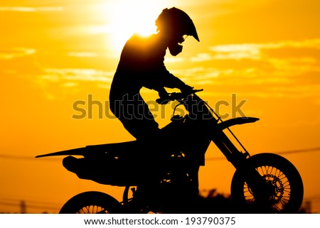 siluate of motard racer back sun light