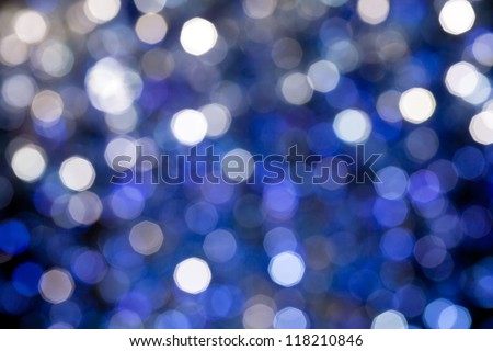 Silver and blue blurred light.  Useful as Christmas background or greeting card.