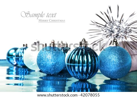 Silver and blue christmas decorations with space for text - stock photo