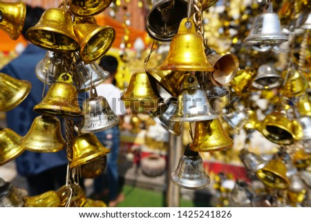 Silver and gold bell ,Bell of temple in thailand. Religious bells in Wat Phra That Phanom,Used in the development of mindfulness since ancient times, Nakhon Phanom, Thailand