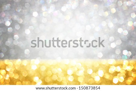 silver and gold defocused lights  background. abstract bokeh lights