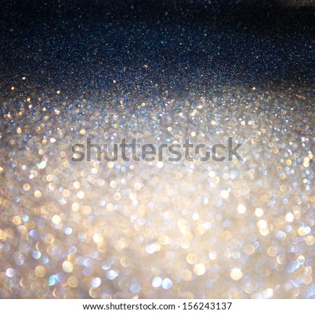 silver and golden background of defocused abstract lights