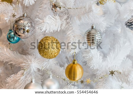 Silver and golden balls garland decoration for christmas and new year festival on white tree #554454646