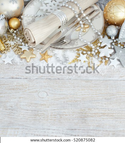 Silver and golden Christmas Table Setting with christmas decorations