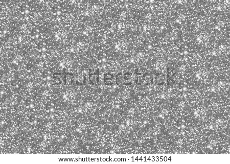 Silver and gray glitter Background. Background filled with shiny glitter. Glitter and Christmas abstract background.