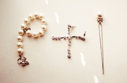 Silver and pearl jewerly lie on the white table