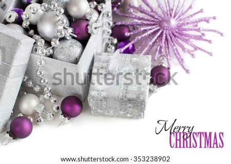 silver and purple christmas ornaments border on white background 353238902