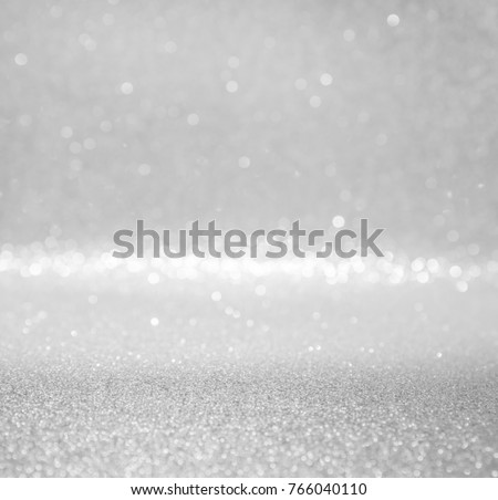 silver and white abstract glitter background with bokeh defocused lights christmas - Shutterstock ID 766040110