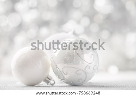 silver and white christmas balls on shiny bokeh background with copy space - White Christmas Balls