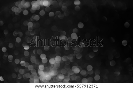 Silver and white glitter abstract bokeh background - Shutterstock ID 557912371