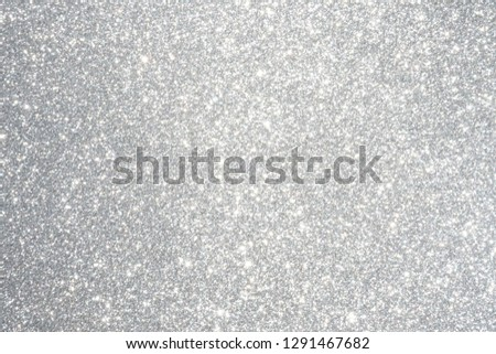 Silver and white glitter abstract bokeh background Christmas
