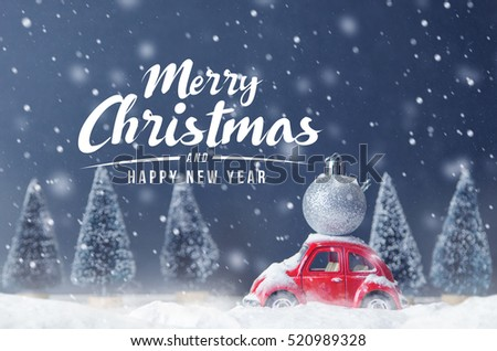 Stock Photo Silver ball christmas on red car toy with blurred tree background and snow, Winter, Merry Christmas holiday celebration and Happy new year concept, copy space, filter effect.