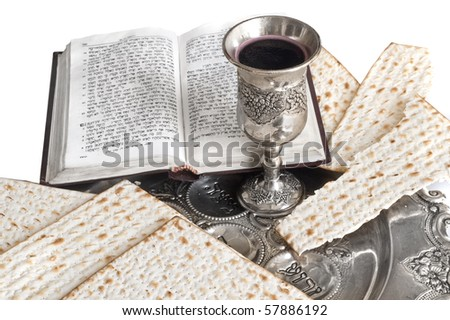 silver beaker with red wine and matzot