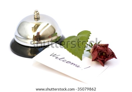 silver bell and welcome inscription isolated on white