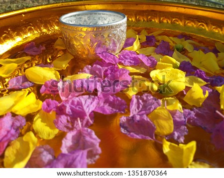 Silver bold in gold bold with water and petal of flowers for Songkran ceremony (Thai New Year). Can used for Songkran festival content.