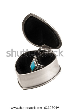 Silver box with a ring inside