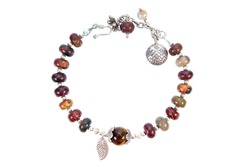 Silver bracelet decoration with color stone beads and flower, leaf, fish, design isolated on white background. Silver bangle decorative with charms beads isolated