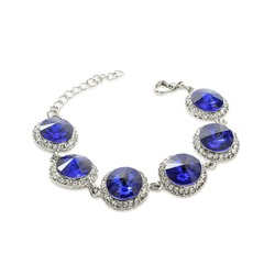 silver bracelet with blue stones isolated on white