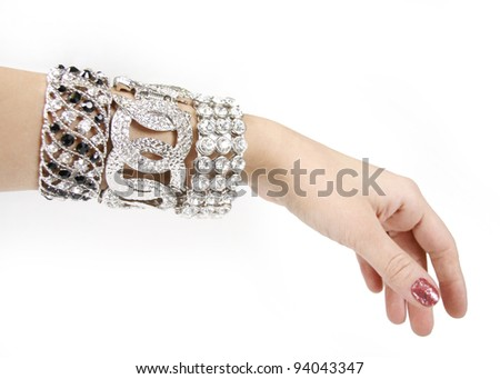 Silver bracelets on woman hand on a white background