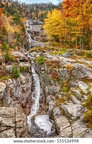 Silver cascade falls in New Hampshire, fall foliage.