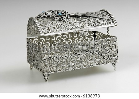 Silver casket isolated on a grey background