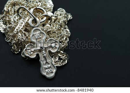 Silver chain with a dagger