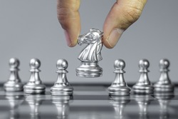 silver Chess knight figure Stand out from the crowd on Chessboard background. Strategy, leadership, business, teamwork, different, Unique and Human resource management concept