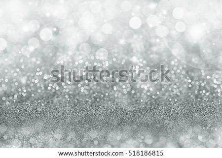 Silver Christmas background with graduated bands of different sparkling and twinkling bokeh from party lights and glitter, full frame copy space for your seasonal greeting #518186815