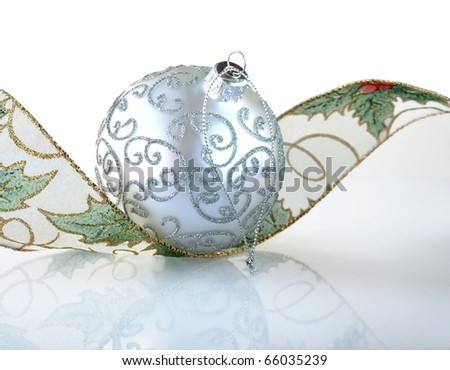 Silver Christmas ball with a curly ribbon