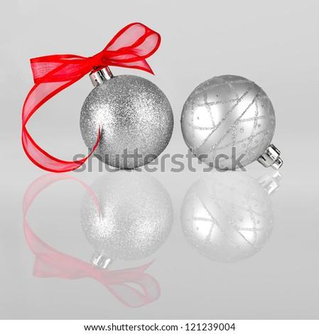 Silver Christmas balls and red ribbon