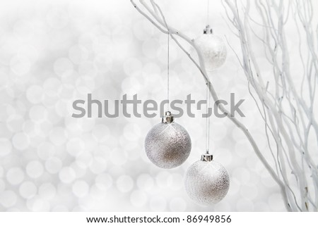 Silver christmas balls hanging on white sticks floral arrangement