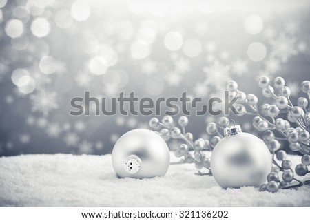 Silver Christmas balls on shiny background