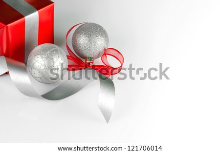 Silver Christmas balls with red ribbon and red gift box with copy space