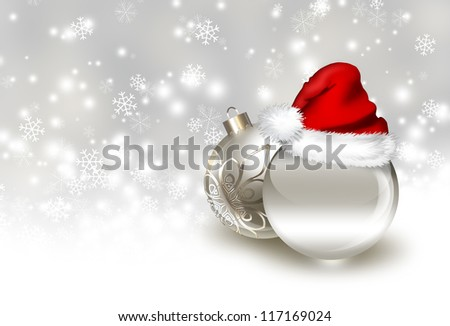 silver christmas balls with Santa hat on a background of falling snow - stock photo