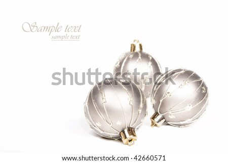 Silver christmas baubles on a white background with space for text