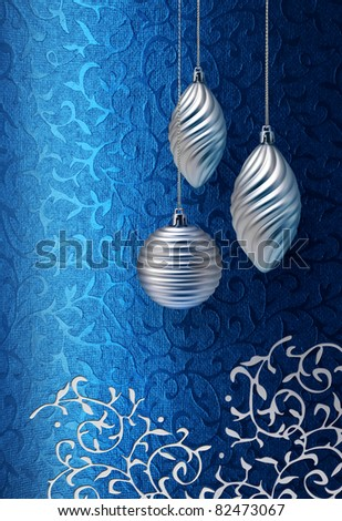 Silver Christmas decoration on blue brocade fabric pattern background