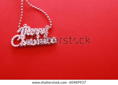 Silver christmas letter garland chain isolated on red - stock photo