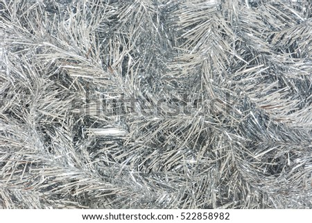 silver Christmas tinsel for background  #522858982