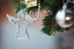 Silver Christmas, xmas angel, decorating fir tree, selective focus