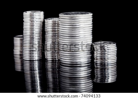 silver coin stack on black