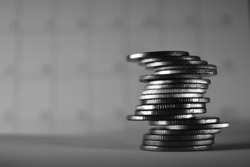 silver coin stack on black and white background.