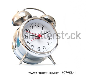 Silver colored alarm clock on white background