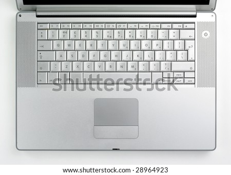 Silver coloured designer lap top key board taken from above