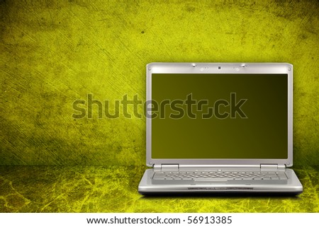 silver computer on green and dirty background