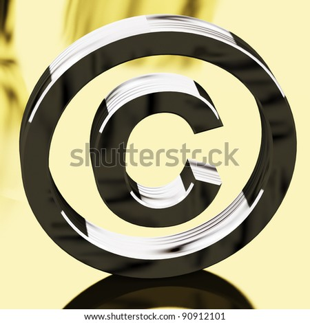 Silver Copyright Sign With Gold Background Representing Patent Protection - stock photo