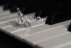 Silver cross with diamonds on the piano, jewerly