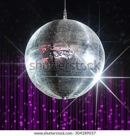 Silver disco ball with stars in nightclub with striped violet and black walls