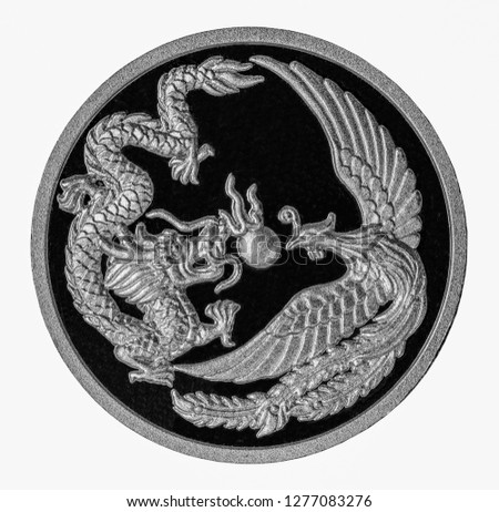 Silver Dragon and swan Ancient design on Silver coins. Close Up UNC Uncirculated - Collection.