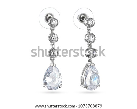 Silver drop earrings with crystals on white background, white gold, jewelry